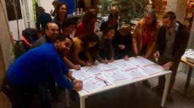 Les représentants des 11 coworkings qui font partie du réseau ont signé la charte modifiée.