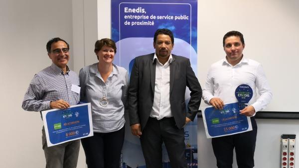 André May (CityLity) et Brice Cruchon (Dracula Technologies) entourent Lethicia Rancurel, directrice du TUBÀ et Patrick Rakotondranahy, directeur territorial Enedis